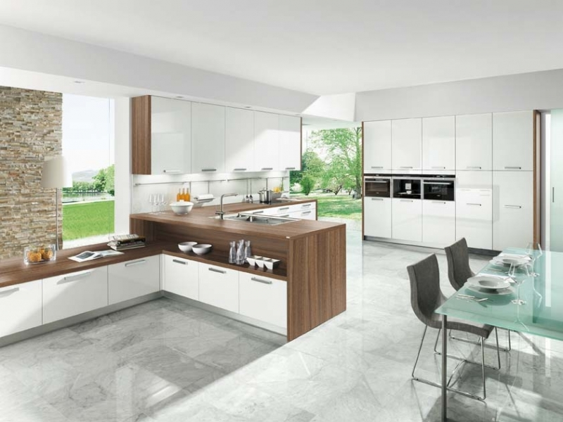 kitchen-comprising-of-astrale-white-acrylic-gloss-cabinets-finished-withwalnut-decor-and-carcass (1).jpg